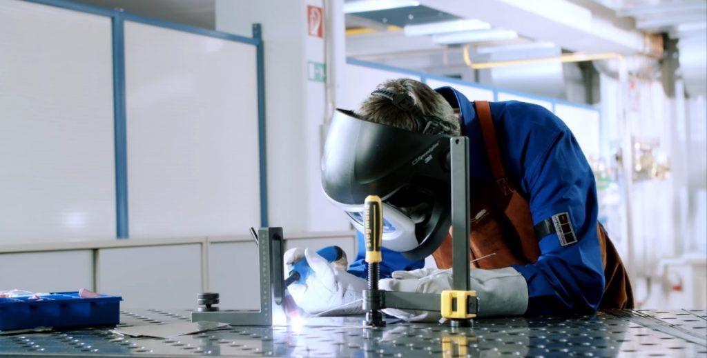 A man is welding with best welding helmet in 2021